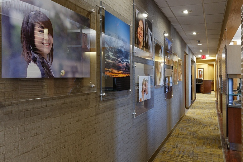 Dental patient photos on wall