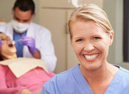 Smiling woman in dental exam room