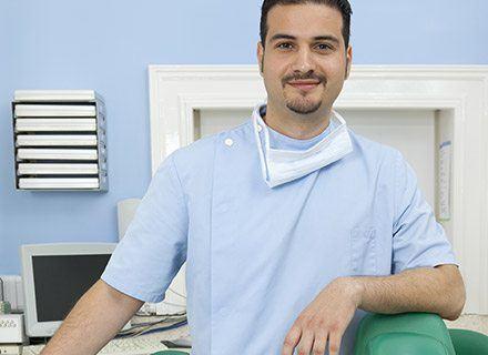 Smiling male dental hygienist