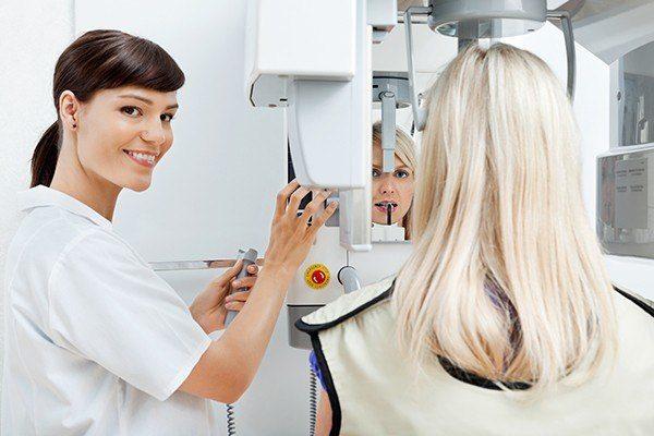 Dental staff checking x-ray