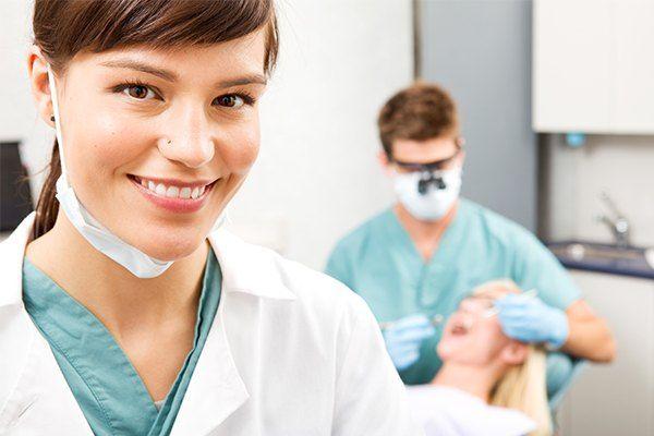 Dental staff smiling