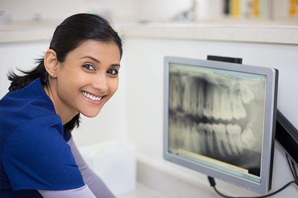 Dental staff chexking x-ray