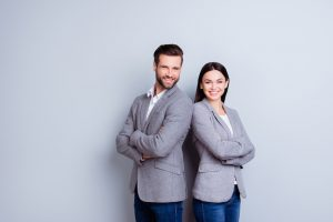 man and woman in front of gray background