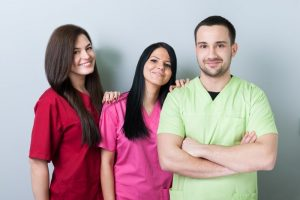 two female and a male aspiring dental assistants