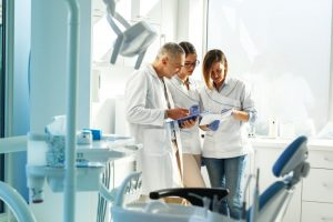 Dental professionals working together in an office