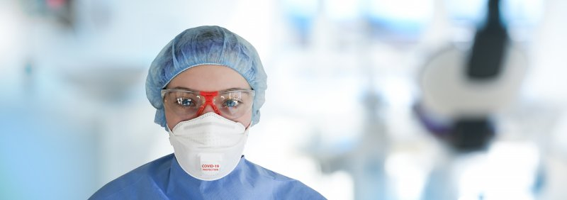 a dental professional wearing one of many different types of face masks