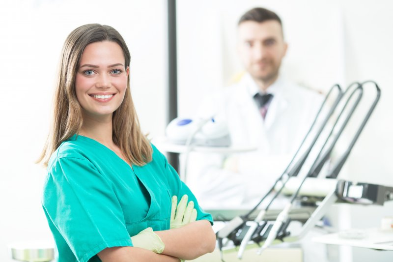 a young female working as a dental assistant in a dentist's office